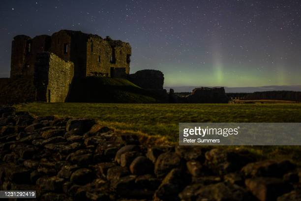The Aurora Borealis is seen above the ruins of Duffus Castle on February 20, 2021 in Duffus, Scotland. The Aurora Borealis, more commonly known as...