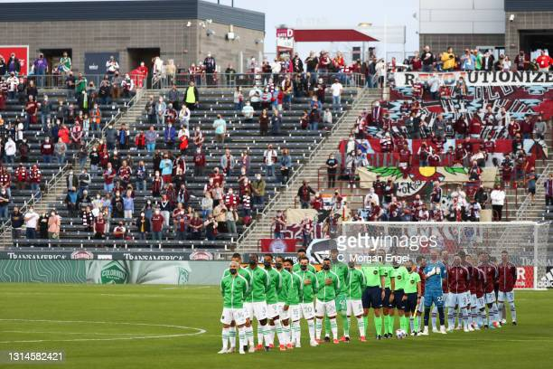 The Austin FC and the Colorado Rapids during the National Anthem prior to the game at Dick's Sporting Goods Park on April 24, 2021 in Commerce City,...