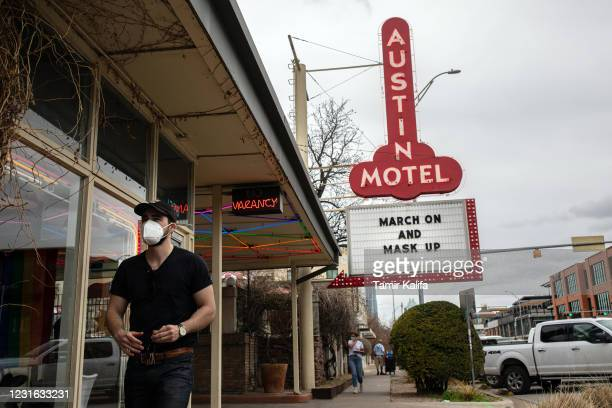 The Austin Motel displays a message on their marquee encouraging people to wear masks on March 10, 2021 in Austin, Texas. The City of Austin said it...