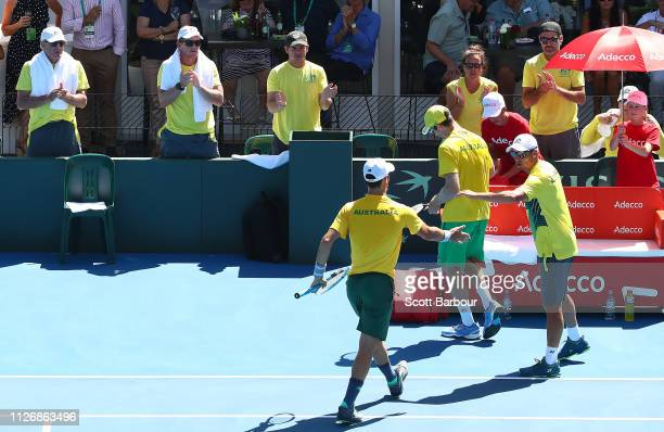 The Australia bench applaud as John Peers and Jordan Thompson of Australia celebrate in their rubber 3 doubles match against Mirza Basic and Tomislav...