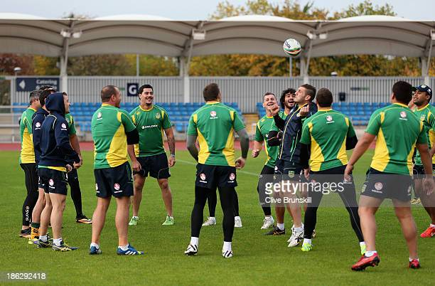 The Australia Kangaroos have fun as they all take part in a warm up exercise during a training session at Sport City Complex on October 30 2013 in...