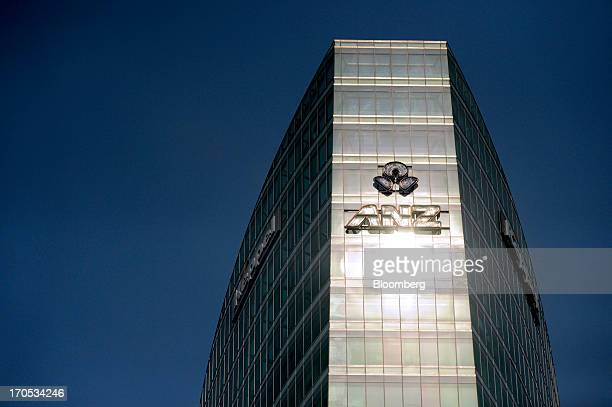 The Australia New Zealand Banking Group Ltd logo is displayed atop Keppel Corp's Ocean Financial Centre in Singapore on Friday June 14 2013...