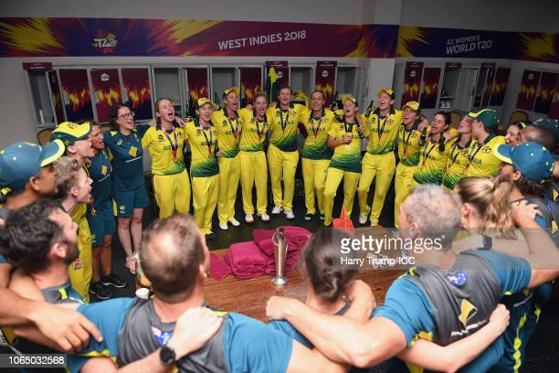 The Australia players and staff celebrate in the changing room after the match with the trophy during the ICC Women's World T20 2018 Final between...