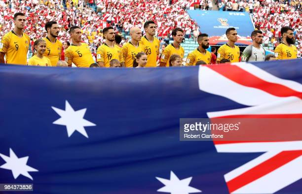 The Australia players line up for national anthem behind a large Australia flag prior to the 2018 FIFA World Cup Russia group C match between...