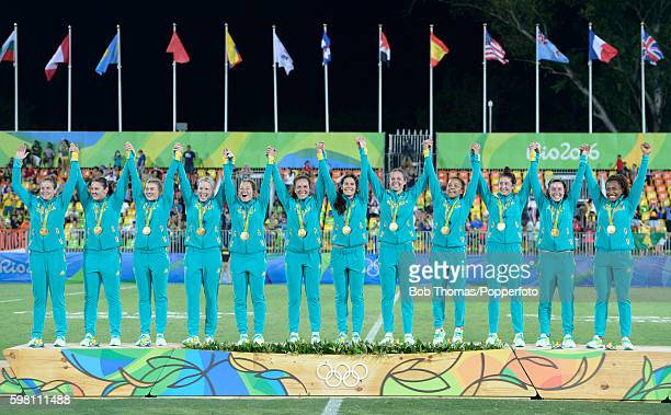 The Australia team celebrate with their gold medals after the Women's Gold Medal Rugby Sevens match between Australia and New Zealand on Day 3 of the...