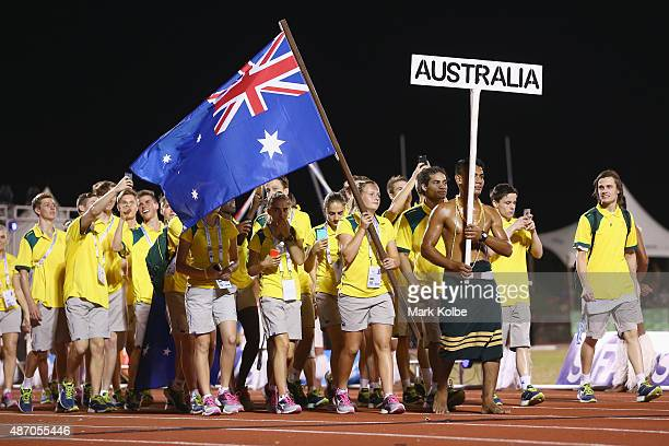 The Australia team march in the parade of the Commonwealth Nations during the 2015 Commonwealth Youth Games Opening Ceremony at Apia Park on...
