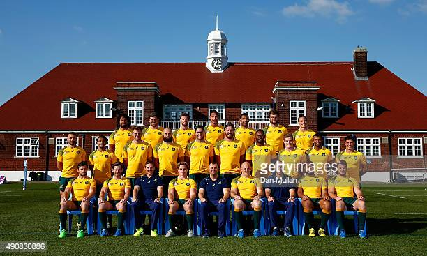 The Australia team named to face England in the 2015 Rugby World Cup Pool A match pose for a group photo with coaching staff following a training...