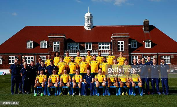 The Australia team named to face England in the 2015 Rugby World Cup Pool A match pose for a group photo with all staff following a training session...