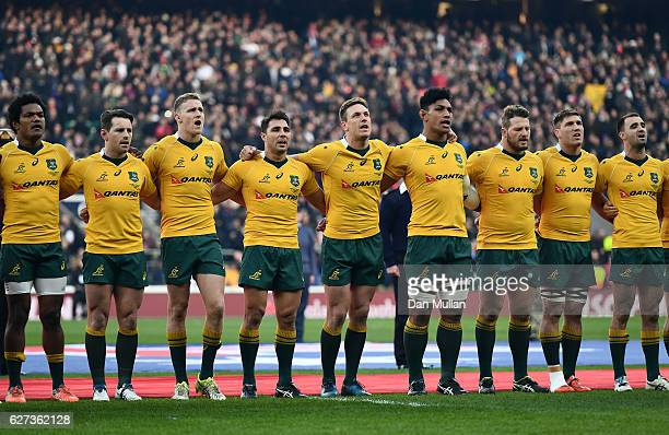 The Australia team take part in the national anthem during the Old Mutual Wealth Series match between England and Australia at Twickenham Stadium on...