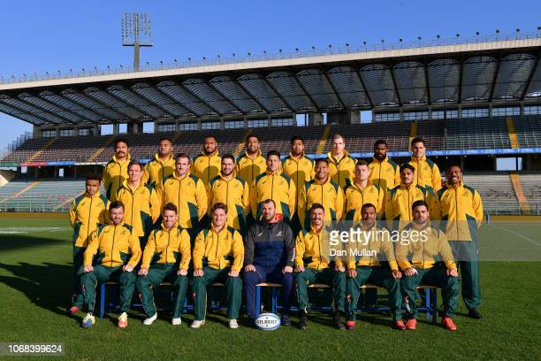 The Australia team to face Italy pose for a team photo with Michael Cheika Head Coach of Australia during the Australia Captain's Run at Stadio...
