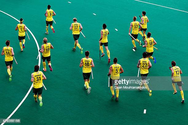 The Australia team warm up prior to the Fintro Hockey World League Semi-Final match between Australia and Great Britain held at KHC Dragons...