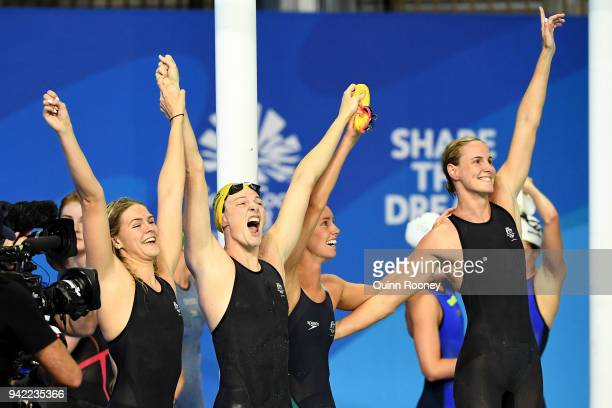 The Australia Women's 4 x 100m Freestyle Relay Final team celebrate victory and a new world record on day one of the Gold Coast 2018 Commonwealth...