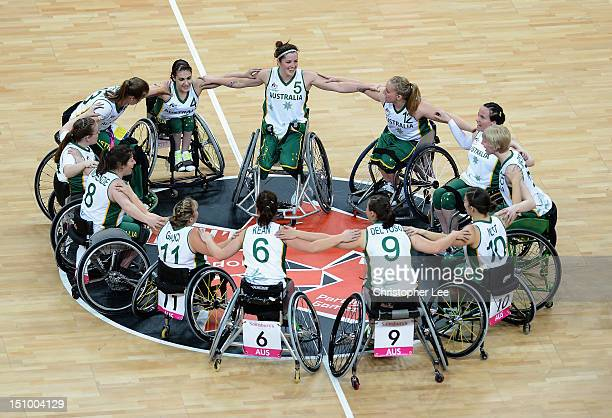 The Australia women's wheelchair basketball team huddle together as they celebrate their victory during the Group A Preliminary Women's Wheelchair...