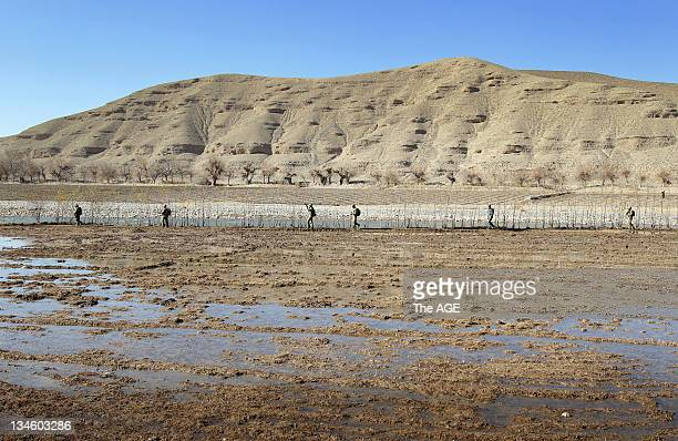 The Australian and Afghan National Army go on a foot patrol from their base in Musazai in the Uruzgan Province in Afghanistan. Pictured is the...