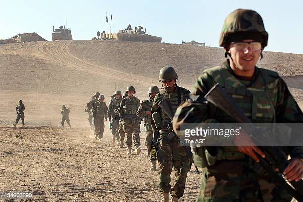 The Australian and Afghan National Army head out from their base to patrol an area of homes at Musazai found in the Uruzgan Province in Afghanistan.