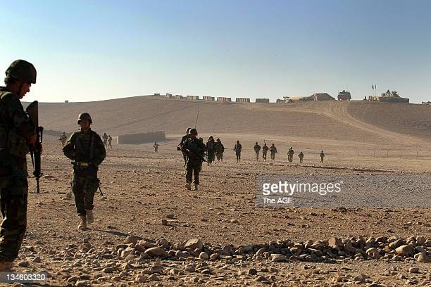 The Australian and Afghan National Army head out from their base to patrol an area of homes at Musazai in Uruzgan Province Afghanistan