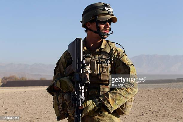 The Australian and Afghan National Army search a village at Musazai in the Uruzgan Province in Afghanistan Pictured is Corporal Marty Speter during...