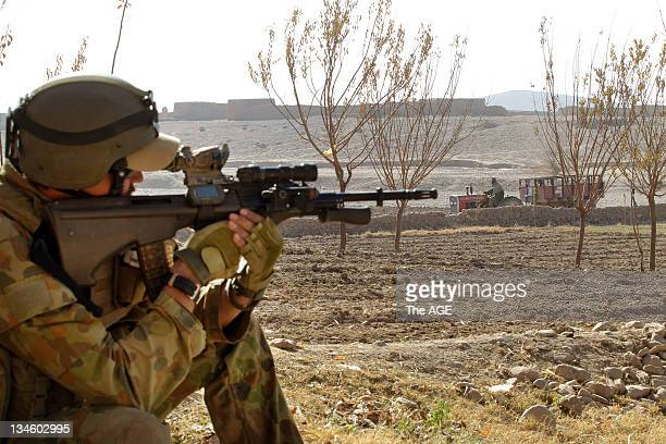 The Australian and Afghan National Army search a village at Musazai in the Uruzgan Province in Afghanistan.