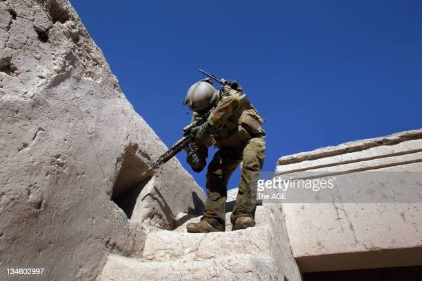 The Australian and Afghan National Army search a village at Musazai in the Uruzgan Province in Afghanistan. Pictured is Sergeant Adam McNamee during...