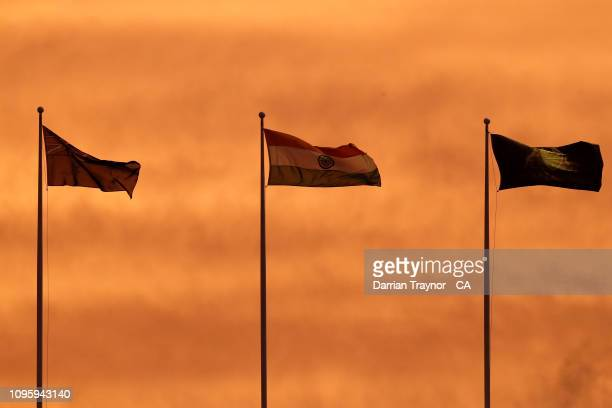 The Australian and Indian flags fly above the M.C.G. At sunset during game three of the One Day International series between Australia and India at...