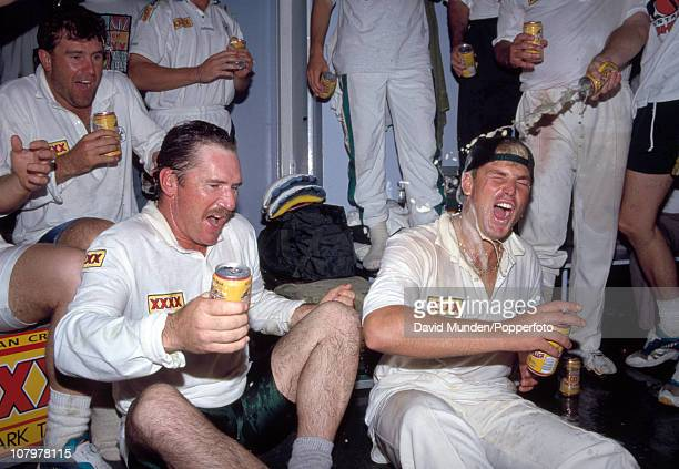 The Australian captain Allan Border and Shane Warne celebrate in the dressing room after the 1st Test match between England and Australia at Old...