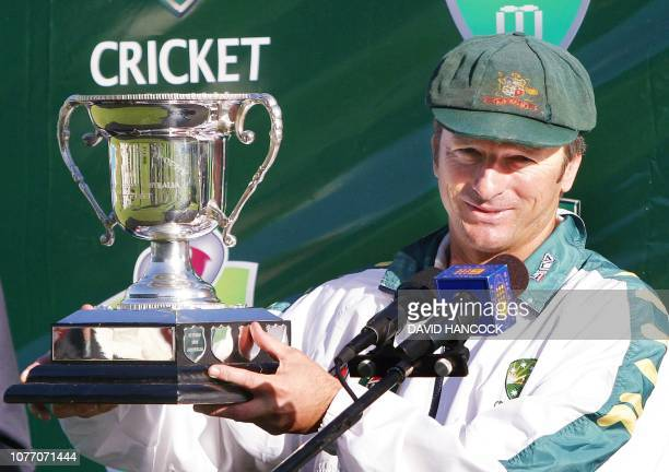 The Australian captain Steve Waugh holds the Southern Cross trophy after his team won the second test and the series against Zimbabwe at Sydney...