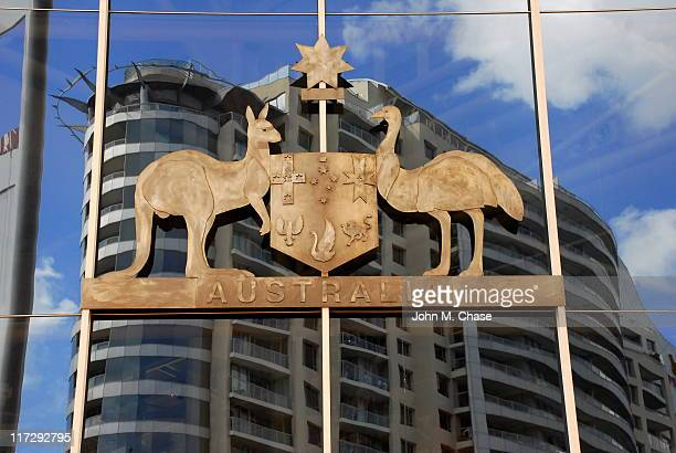 the australian coat of arms as seen on building exterior - british empire stock pictures, royalty-free photos & images