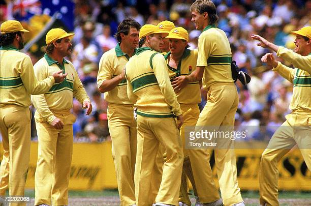 The Australian cricket team celebrate after Bruce Reid takes a wicket during the Benson Hedges World Series Cup 2nd final match between Australia and...