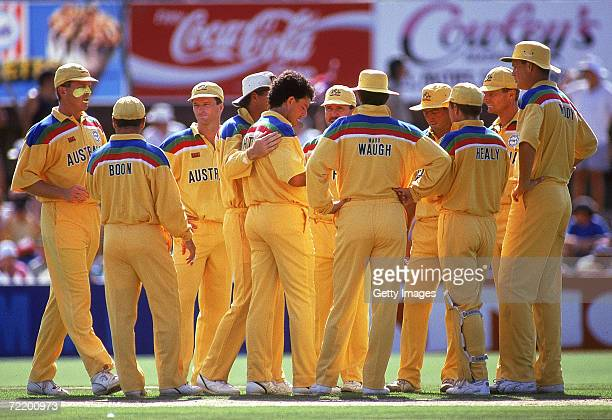 The Australian cricket team celebrate after taking a wicket during the Benson Hedges World Cup match between Australia and Sri Lanka at the Adelaide...