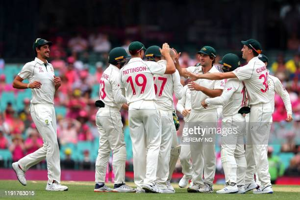The Australian cricket team celebrates the wicket of New Zealand's Tom Blundell bowled by Australia Nathan Lyon during the third day of the third...