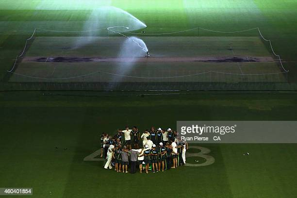 The Australian Cricket Team leave the ground after singing their team song over the '408' in a tribute to the late Phillip Hughes during day five of...