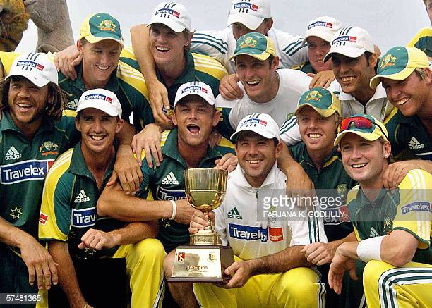 The Australian cricket team pose with their winning trophy at the end of the third and final One Day International match between Bangladesh and...