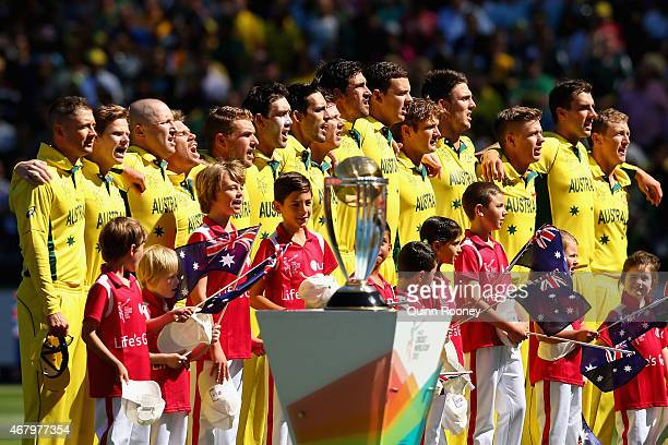 The Australian cricket team stand for the national anthem during the 2015 ICC Cricket World Cup final match between Australia and New Zealand at...