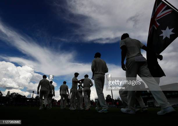 The Australian Cricket Team take to the field during day three of the Second Test match between Australia and Sri Lanka at Manuka Oval on February 03...