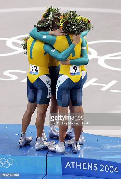 The Australian cycling men's pursuit team of Brad McGee Graeme Brown Brett Lancaster and Luke Roberts celebrate winning the gold medal SMH OLYMPICS...