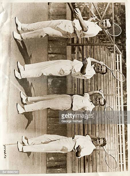 The Australian Davis Cup tennis team at their first practice on the Berkeley Tennis Club courts just after their recent arrival in San Francisco Left...