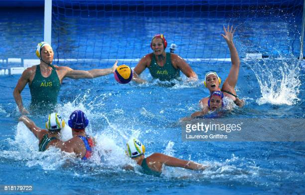 The Australian defence scrambles as Maria Borisova of Russia shoots on goal during the Women's Water Polo Group D preliminary round match between...