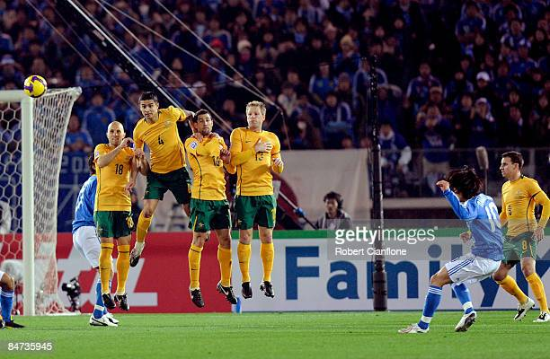 The Australian defensive wall look to block a free kick from Shunsuke Nakamura of Japan during the 2010 FIFA World Cup Asian qualifying match between...