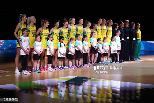 The Australian Diamonds are seen during the Australian national anthem prior to the Quad Series International Test match between the Australian...