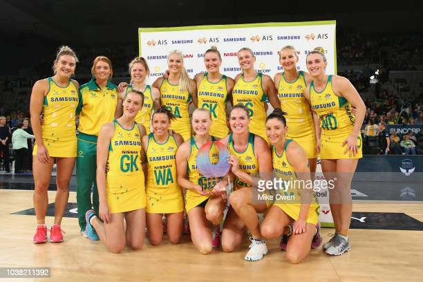 The Australian Diamonds celebrate with the trophy after winning the Quad Series International Test match between the Australian Diamonds and the New...