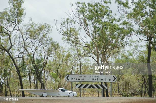 The Australian entered Solar Resource Syndicate solar-powered car drives on Stuart Highway during the inaugural Darwin to Adelaide Pentax World Solar...