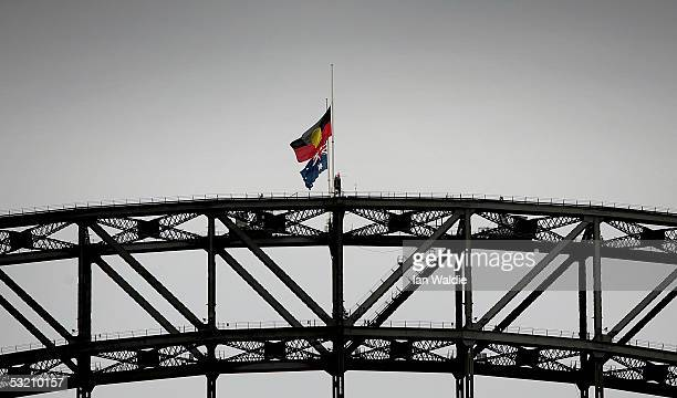 The Australian flag and the Aboriginal flag fly at halfmast as a mark of respect to the victims of the London bombs on the Sydney Harbour Bridge July...