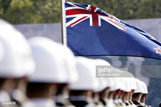 The Australian flag flies above marching Turkish soldiers during ceremonies marking the 90th anniversary of the Anzac Day western Turkey 24 April...