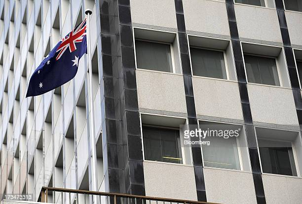 The Australian flag flies outside the Reserve Bank of Australia headquarters in the central business district of Sydney Australia on Monday July 15...