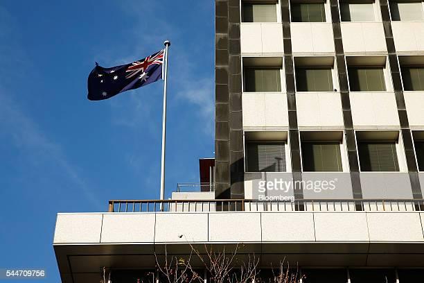 The Australian flag flies outside the Reserve Bank of Australia headquarters in Sydney Australia on Monday July 4 2016 Australia's failure to make a...
