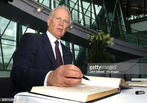 The Australian High Commissioner Richard Alston signs the Book of Condolences for the victims of last week's terror blasts, at the London City Hall...