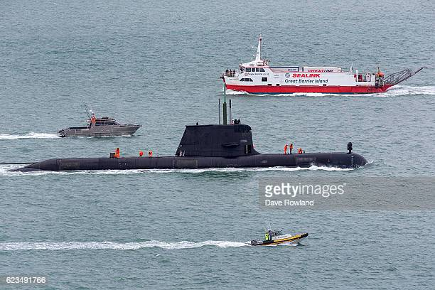 The Australian HMAS Dechaineux submarine passes a car ferry as she enters the harbour with the fleet on November 16 2016 in Auckland New Zealand The...