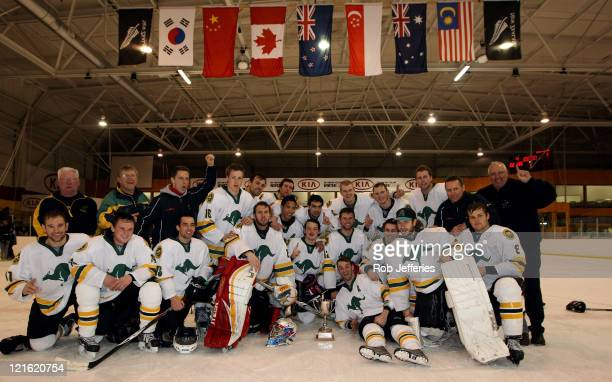 The Australian Ice Hockey Team poses with winners trophy after Australia won the Ice Hockey Finals match between Australia and New Zealand during day...