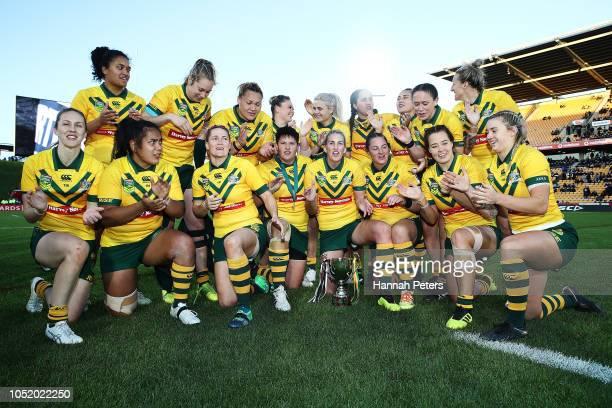 The Australian Jillaroos celebrate after winning the international Women's Rugby League Test Match between the New Zealand Kiwi Ferns and the...