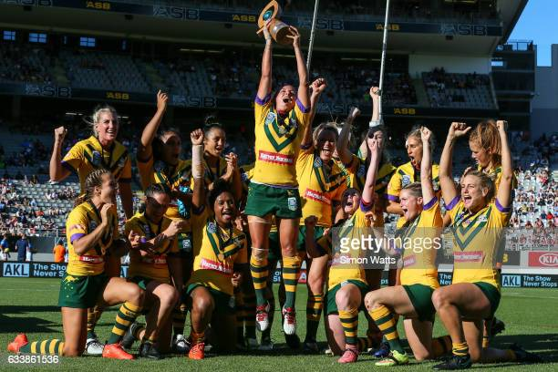 The Australian Jillaroos celebrate beating the Kiwi Ferns during the 2017 Auckland Nines at Eden Park on February 5 2017 in Auckland New Zealand